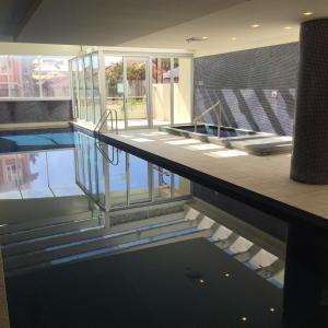 The swimming pool at or near GlenelgApt