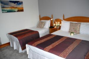 A bed or beds in a room at Ferryport House B&B