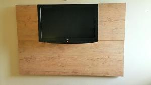 Uma TV ou centro de entretenimento em Apartamento Barra Pé na Areia
