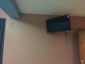 A television and/or entertainment center at Hostal El Palace
