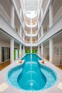 The swimming pool at or near Hi Chiangrai Hotel