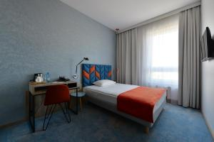 A bed or beds in a room at Hotel Faros