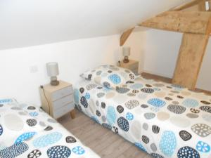 """A bed or beds in a room at Gîtes """"Le Gazeau"""""""