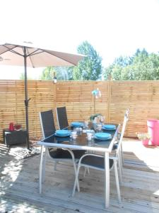 """A porch or other outdoor area at Gîtes """"Le Gazeau"""""""