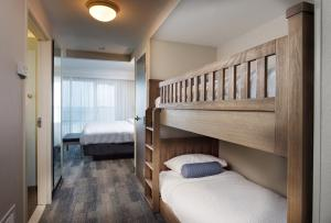 A bunk bed or bunk beds in a room at SpringHill Suites by Marriott Pensacola Beach