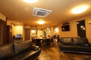 The lounge or bar area at Guest House Ouka
