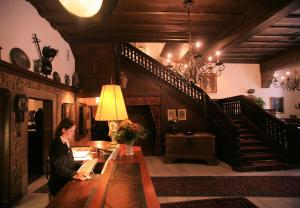 The lobby or reception area at Hotel Eisenhut