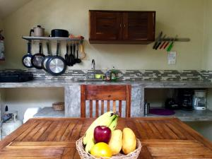A kitchen or kitchenette at Tulum's - 1 & 2 Room APMTs