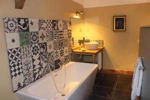 A bathroom at Ferme-Château de Cordey & Spa
