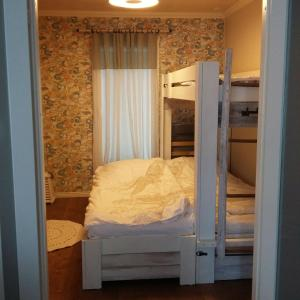 A bunk bed or bunk beds in a room at Villa Graniitti