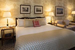 A bed or beds in a room at Williamsburg Inn - A Colonial Williamsburg Hotel