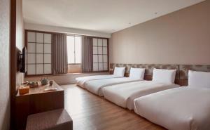 福泰桔子商旅- 文化店房間的床
