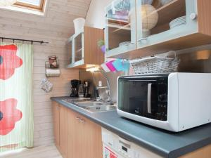 A kitchen or kitchenette at Beautiful Apartment in Spa Belgium with Jacuzzi