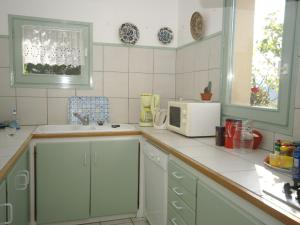 A kitchen or kitchenette at Beautiful Holiday Home in Marignac-en-Diois with Pool