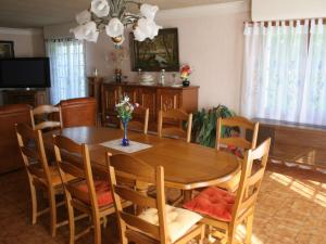 A restaurant or other place to eat at Modern Holiday Home in La Foret-Fouesnant with Swimming Pool