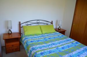 A bed or beds in a room at Sandy Dunes Beach House