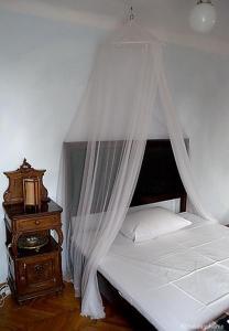 Ein Bett oder Betten in einem Zimmer der Unterkunft Casa di Rose