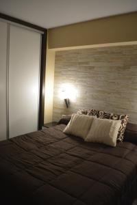 A bed or beds in a room at Apartamento Beli