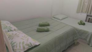 A bed or beds in a room at Sossego na Transcarioca