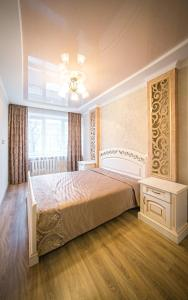 A bed or beds in a room at Apartments on Svobody Avenue- the center of Lviv