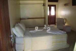 A bed or beds in a room at Pousada Portal do Maragogi