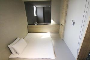 ネクスト タイペイ ホステル シーメンディンにあるベッド
