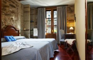 Una habitación en Hotel Rua Villar