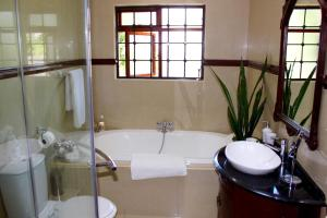 A bathroom at The Oasis Residency