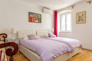A bed or beds in a room at Best Of Split Apartments