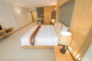 A bed or beds in a room at Oldtown Chiangmai Boutique