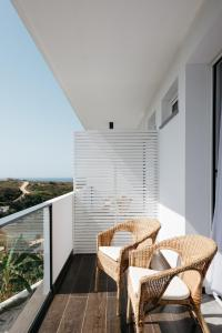 A balcony or terrace at O Lugar