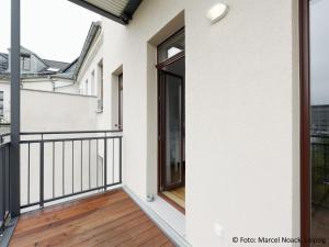Ein Balkon oder eine Terrasse in der Unterkunft City Park Apartments - #13-20 - Moderne Apartments & Suiten im Zentrum
