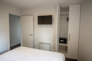 A bed or beds in a room at Te Anau Luxury Apartments