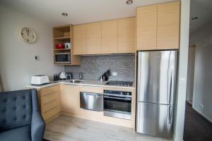 A kitchen or kitchenette at Te Anau Luxury Apartments