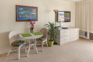 A television and/or entertainment center at Tropical Studios at Marine Surf Waikiki