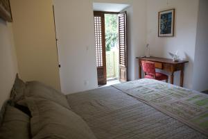 A bed or beds in a room at Irradiante