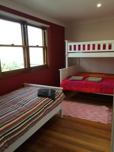 A bunk bed or bunk beds in a room at By The Bay