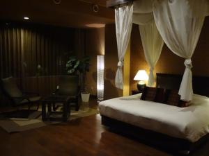 A bed or beds in a room at Breezbay Seaside Resort Matsushima