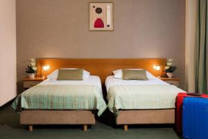 Кровать или кровати в номере Best Western Hotel Galicya