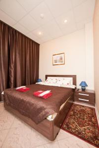 Кровать или кровати в номере Отель Ладомир в Филях