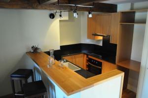 Una cocina o zona de cocina en Appart hotel & spa Cerdanya