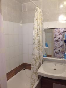 A bathroom at Apartment on Polevaya 7