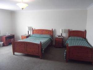 A bed or beds in a room at The Windsor Hotel