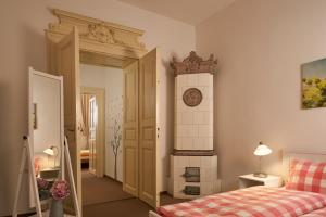A bed or beds in a room at Old Town Apartment Konviktska