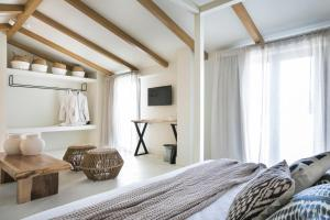 A bed or beds in a room at Kefalonia Grand