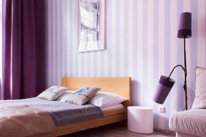 Ein Bett oder Betten in einem Zimmer der Unterkunft Royal Court Legerova