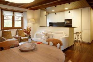 A seating area at Val de Ruda Luxe 6 by FeelFree Rentals