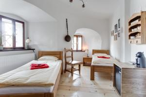 A bed or beds in a room at Krumlov Tower