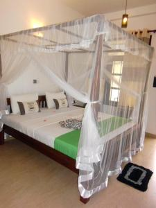 A bed or beds in a room at Pelli Riverine