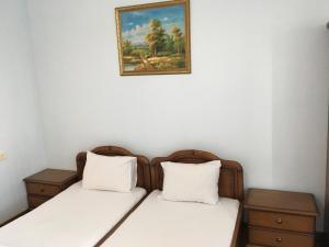 Кровать или кровати в номере Apartments Tigran Petrosyan 39/5